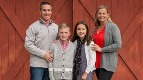 Stroke survivor Lisa Deck with her husband and children