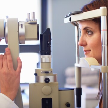 A patient has her eyes scanned by a healthcare professional