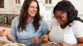Two women eating a healthy meal