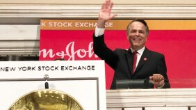 Thibaut Mongon ringing the bell at the New York Stock Exchange