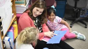 Joy Marini with children at a school in Whitley County, Kentucky