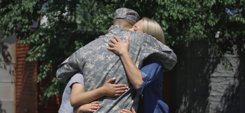 Service member hugs family