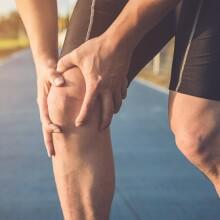Runner holding knee