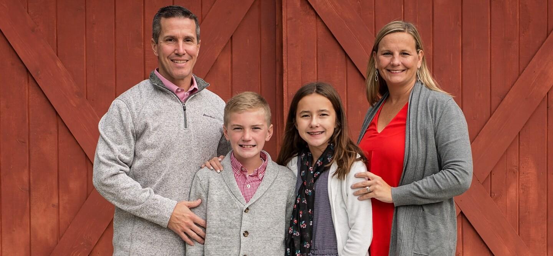 Stroke survivor Lisa Deck with her husband and children