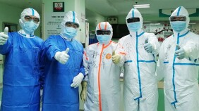 Doctors on the frontlines of the coronavirus outbreak in Wuhan, China, posing in their protective equipment