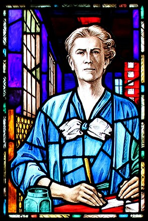 A stained glass window portrait depicting Elizabeth P., who was a Johnson & Johnson label department supervisor