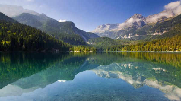 A landscape of a lake and mountains