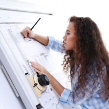 Woman completing an architecture drawing