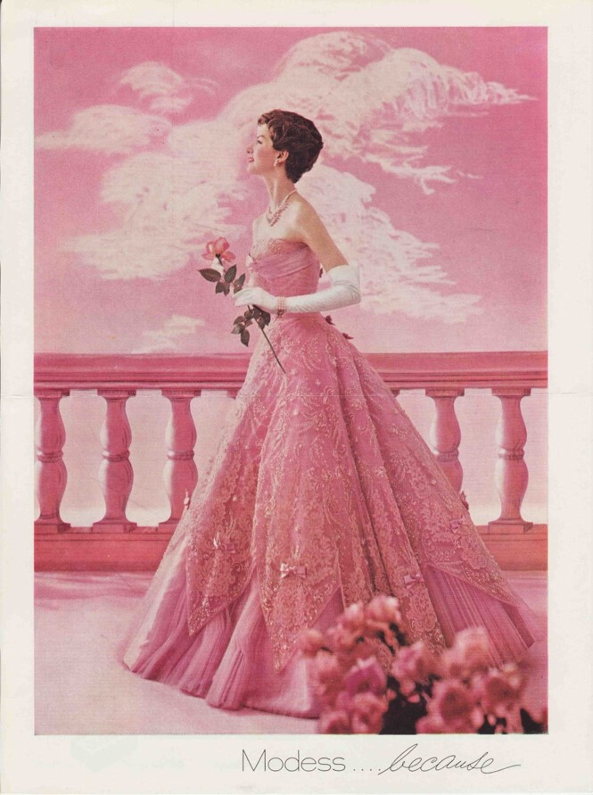 Woman modeling pink dress for the Modess Because campaign