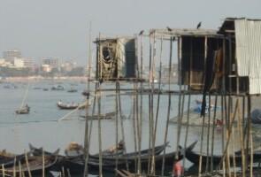 Hanging latrine in Karmrangir Char, Dhaka, Bangladesh. (Photo by Gary White/Water.org)