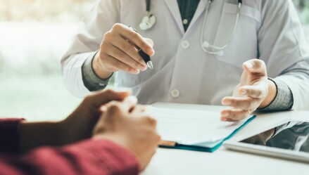 Doctor consults with a patient